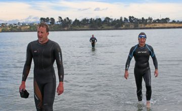 Ocean swimmers Andy Collins & Tim Holt reach shore.