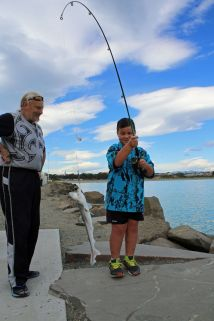 Mason McLeod hooks a good sized dogfish, with a little help from his grandfather Darrel Ramage.