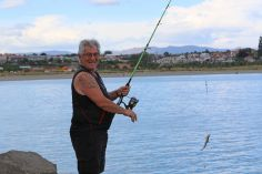 Toni Thomas from Christchurch hooks a wee dog fish.