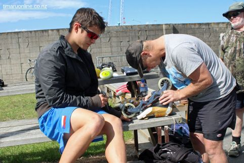 Simon Pravda (L) from the Czech Republic gets some assistance with setting up his skates.