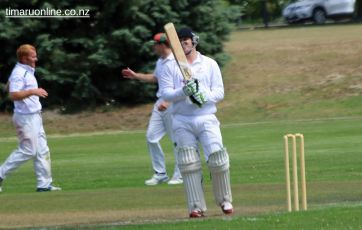 Dan Laming (Celtic, left) celebrates a caught and bowled dismissal