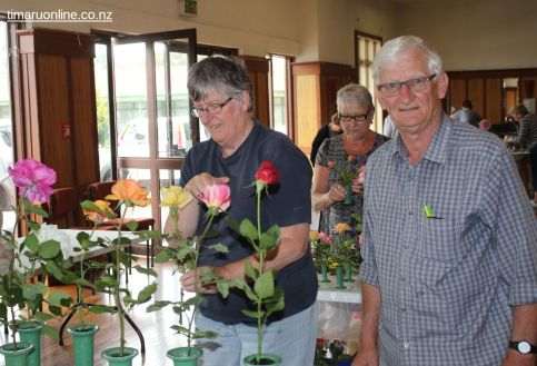 Margaret & Bevan Johnson arrange their roses for display