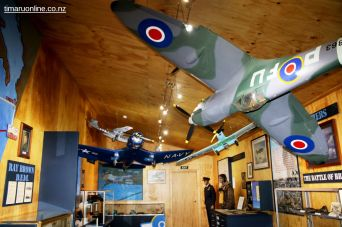 Model military aircraft in the museum section.