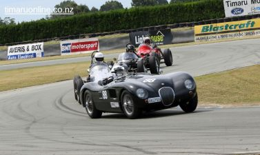 David Owen (88) corners his 1953 Jaguar C Type Replica, 3485 cc