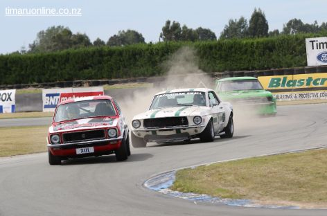 Centre: Mike Small, from Timaru, stirs the dust in his Ford Mustang