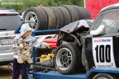 Surveying the damage after Michelle Lindsay-Koni's Holden EH hit the tire barrier