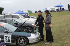 Wei Li, from Christchurch, adds oil to his Honda Integra