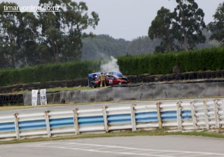 Two cars rolled at the end of the main straight.