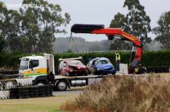 Although both cars were badly damaged, their roll cages saved the drivers from serious injury