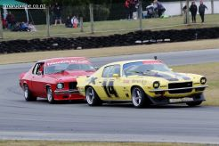 Graeme Allan's Chev Camaro is chased hard by John Hepburn's Holden Monaro