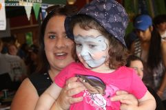 Mum Stacery Walker lifts, while daughter Sophie (3) checks out the facepaint in the mirror