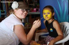 Hannah Gee does some face painting
