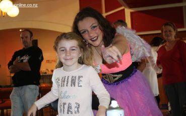 Gracie McGartland (6) gets a flash hair-do from Maia Duncan