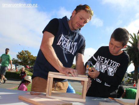 Kyle and Jordan Frandsen (11) construct a Mitre 10 bird house