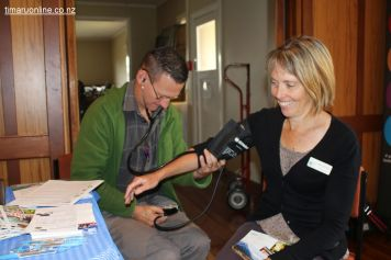 Julian Waller (SCDHB Stroke Services) checks Tania Metherell's blood pressure
