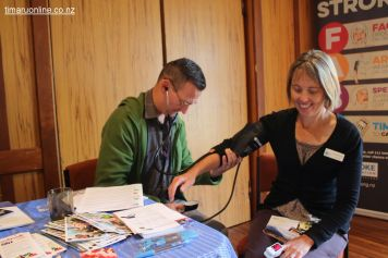 Julian Waller (SCDHB Stroke Services) checks Tania Metherell's blood pressure.