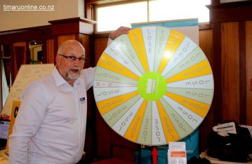 "Clive Callow (Community Trust Mid & South Canterbury) falls victim to the Problem Gambling Foundation ""winning"" wheel"