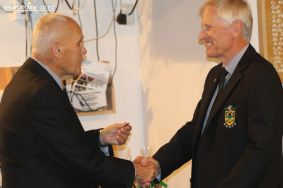 Outgoing President congratulates Murray Roberts on his election as President.