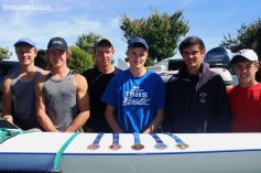 Members of the rowing squad show off their medals