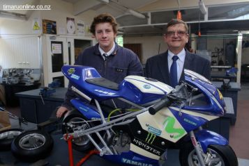 Ethan Shields and head of Technology, Michael Howard, with a mini-motocycle (senior technology project)