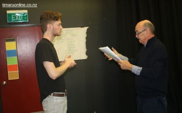 Drama teacher, Don McCully, takes Johannes Runge through his lines