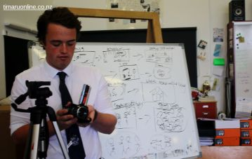Jack Winsley (Yr 13) gets the video camera ready for action.