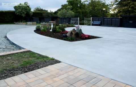 The outdoor area is wheelchair accessible and features a number of raised gardens
