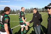 Luke Brice is congratulated by coach Barry Matthews